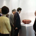 Japanese Prime Minister Shinzo Abe (C) observing an artefact at the Japan Creative Centre.