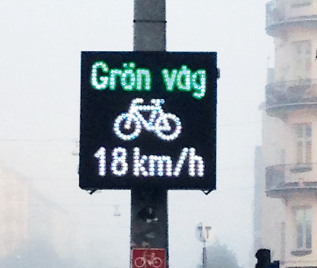 Bright white signs for cyclists in Stockholm