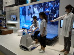Self-reliance support robot (prototype) helps users get in and out of bed.
