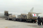 Japanese SDF plane takes off with gear for Ebola fight