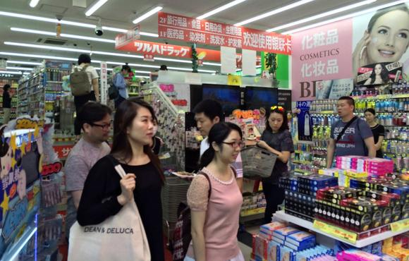 Foreign tourists hunt for cosmetics at a drugstore in Osaka.